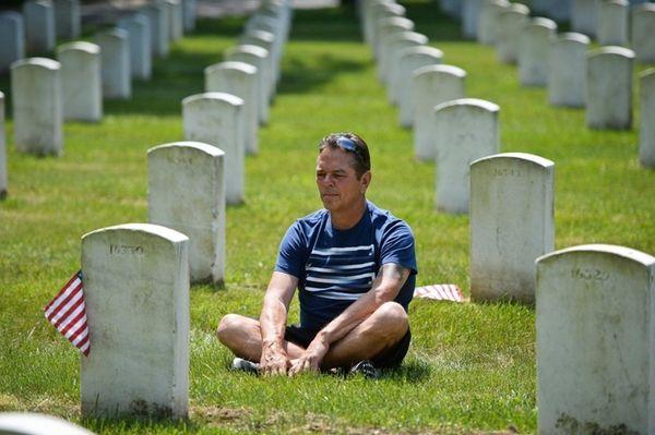 Bob Prego of Ronkonkoma sits at his late