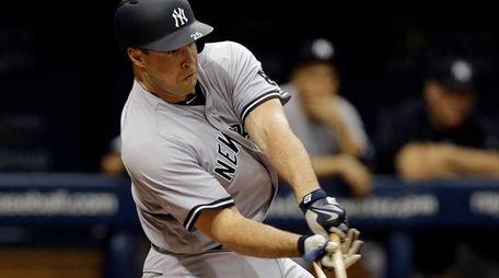 New York Yankees' Mark Teixeira breaks his bat