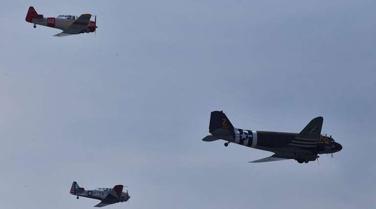 The Warbirds, a vintage aircraft flying group, perform