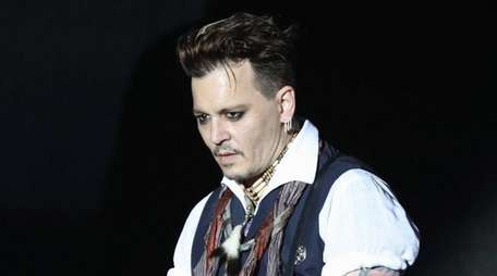 Johnny Depp performs onstage with his band, Hollywood