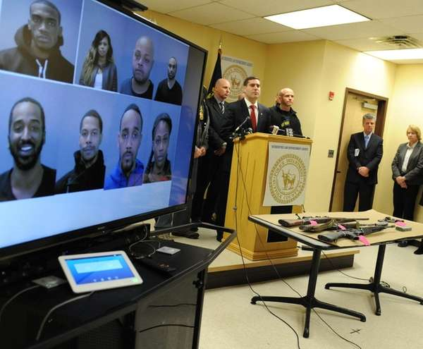 Suffolk County Police Commissioner Tim Sini addresses the