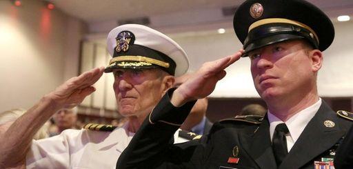 Retired Navy Cmdr. William Seidenstein, left, and his