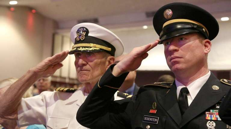 Retired Navy Cmdr. William Seidenstein, left, and his
