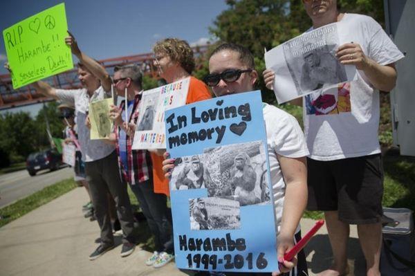 Kate Villanueva of Erlanger, Kentucky, center right, holds
