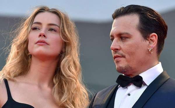 Estranged couple Amber Heard and Johnny Depp attend