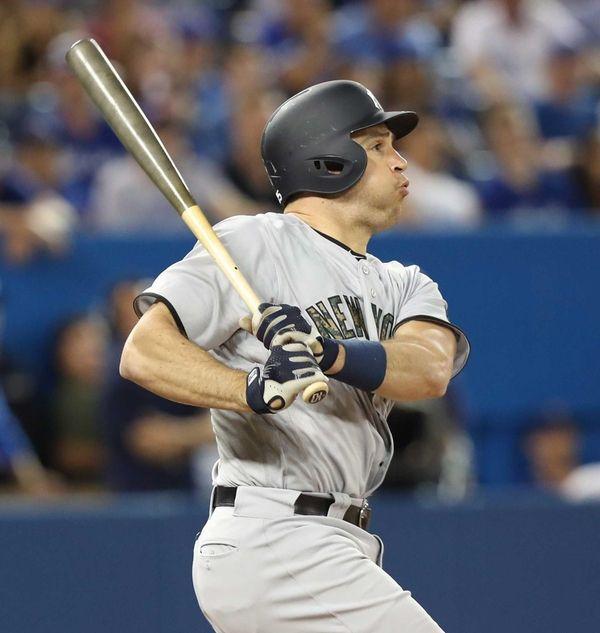 The New York Yankees' Mark Teixeira hits a