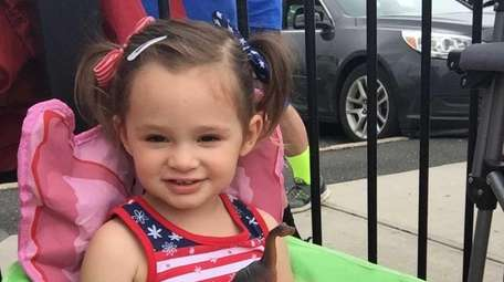 Victoria S. watching the Smithtown Memorial Day parade