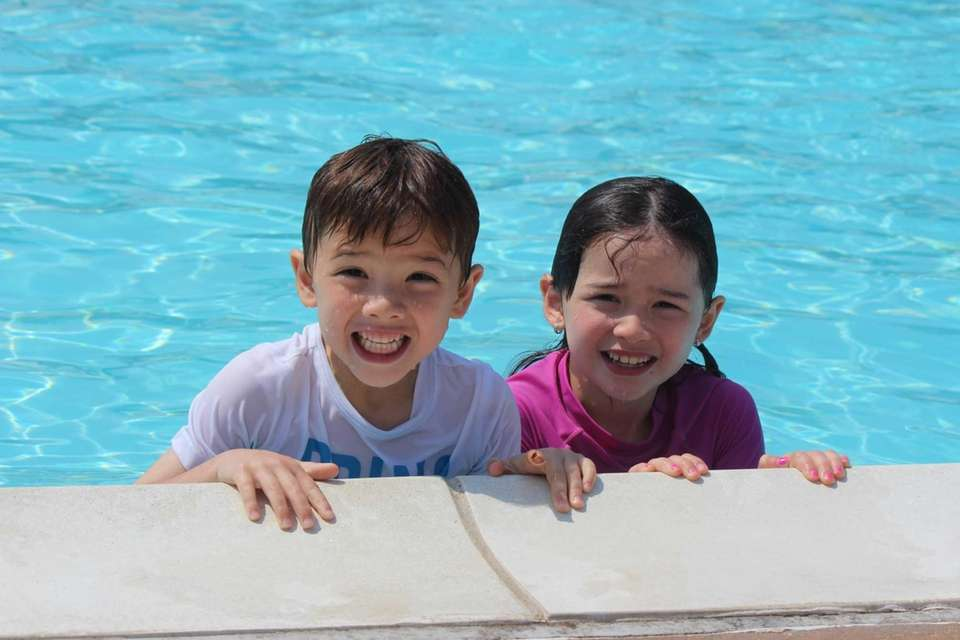 Madison, 7, and Sammy, 6, swimming in the