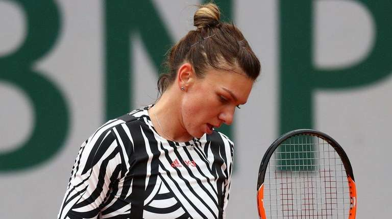 Simona Halep reacts during the ladies singles fourth-round