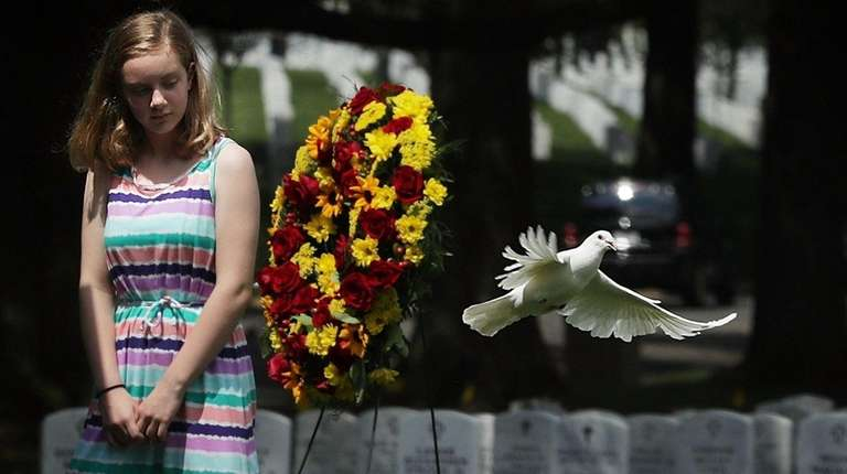 Great grandniece Madeline Brumbaugh watches a dove flying