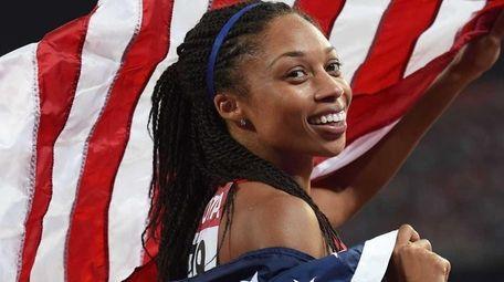 USA's Allyson Felix celebrates after winning the final