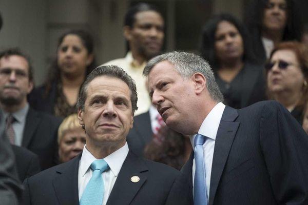 Gov. Andrew Cuomo listens to Mayor Bill de