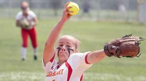 Winning pitcher for Sacred Heart, Claire O'Brien fires