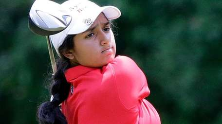 Syosset's Malini Rudra with the tee shot at