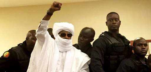 Chad's former dictator, Hissène Habré raises his fist
