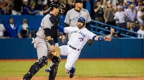 Toronto Blue Jays' Kevin Pillar scores against New