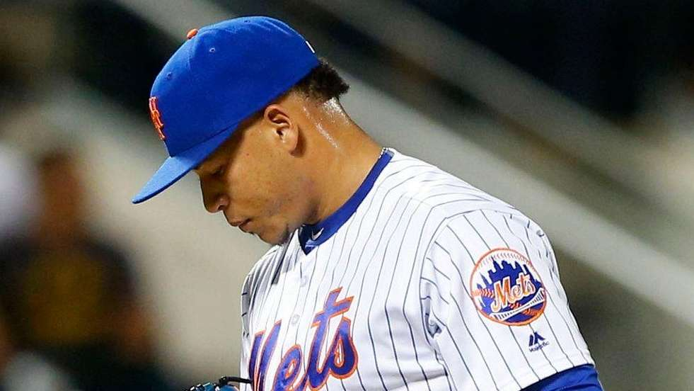 Hansel Robles of the Mets stands on the