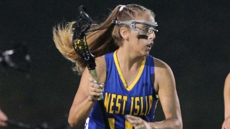 West Islip's Emily Piciullo (15) carries the ball