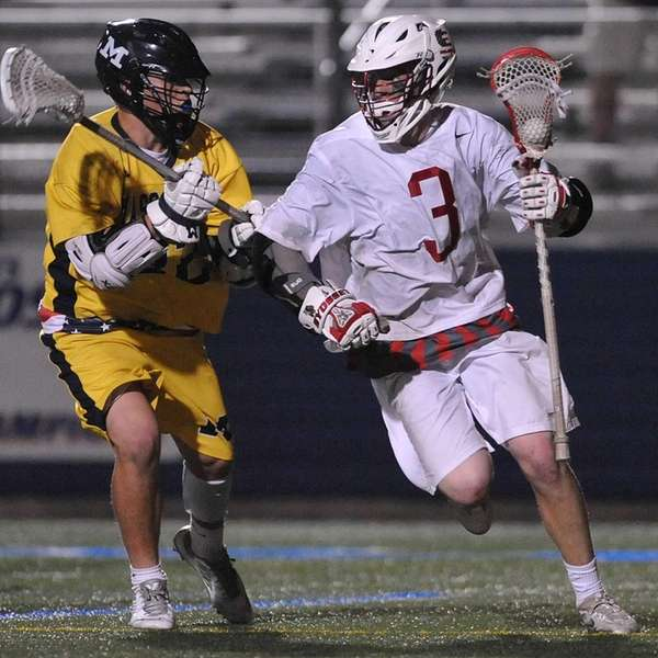 Mac O'Keefe #3 of Syosset, right, gets pressured