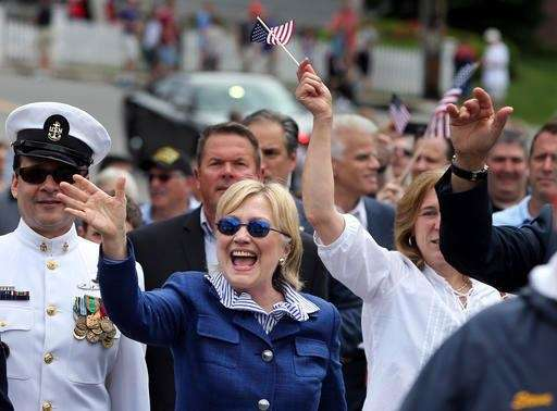 Democratic presidential candidate Hillary Clinton walks in a