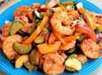 Shrimp, zucchini, red bell peppers and peaches are