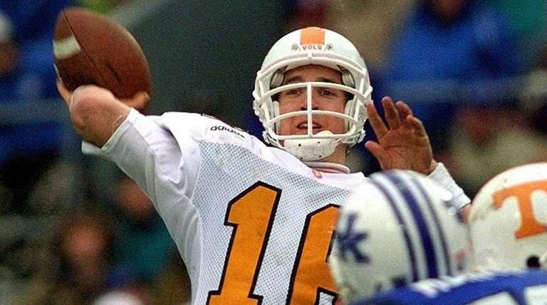 Tennessee quarterback Peyton Manning launches a pass during