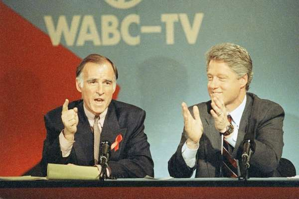 Jerry Brown, left, and Bill Clinton during a