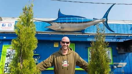 Jonathan Bloom, from Amagansett, poses with a marlin