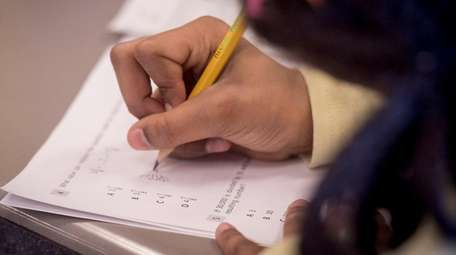 A fourth-grader at Ulysses Byas Elementary School in
