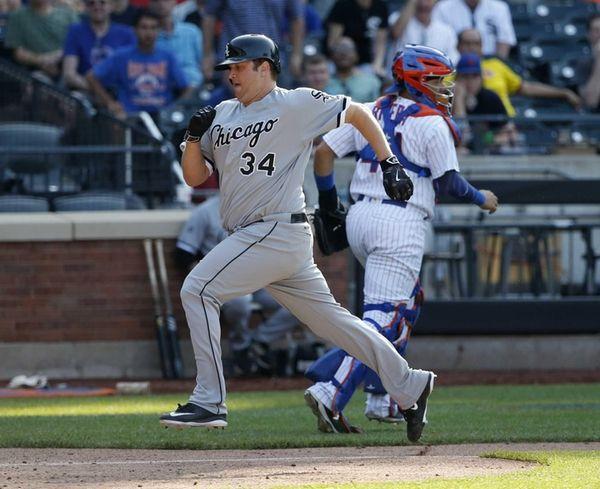 Chicago White Sox Matt Albers (34) scores on