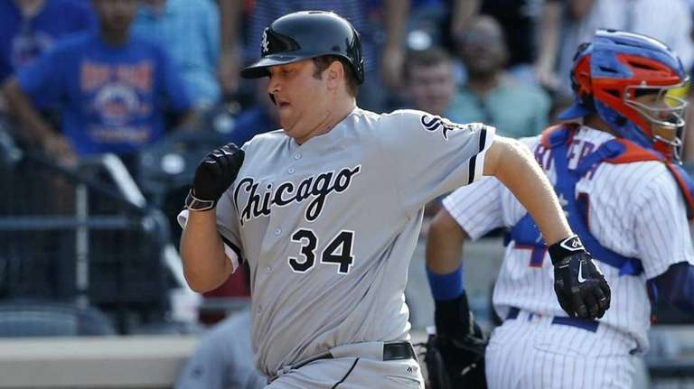 Chicago White Sox Matt Albers (34) scores on