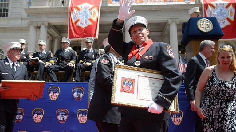 FDNY Lt. Brian J. Colleluori of Bethpage waves