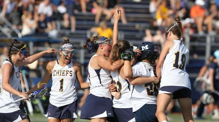Massapequa celebrates the win during the Nassau School