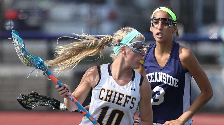 Massapequa's Allison Stackpole (10) carries the ball in