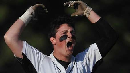 Will O'Brien #13 of Wantagh reacts after delivering