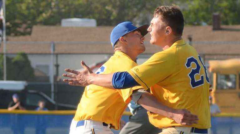 West Islip's Ray Weber (left) and winning pitcher