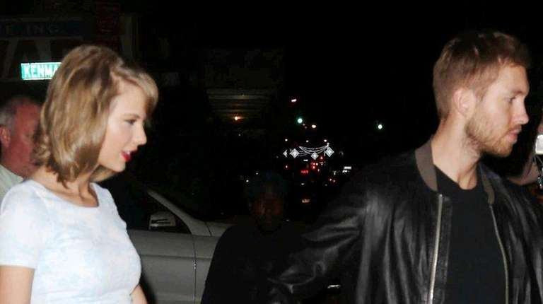 Taylor Swift and Calvin Harris are seen in