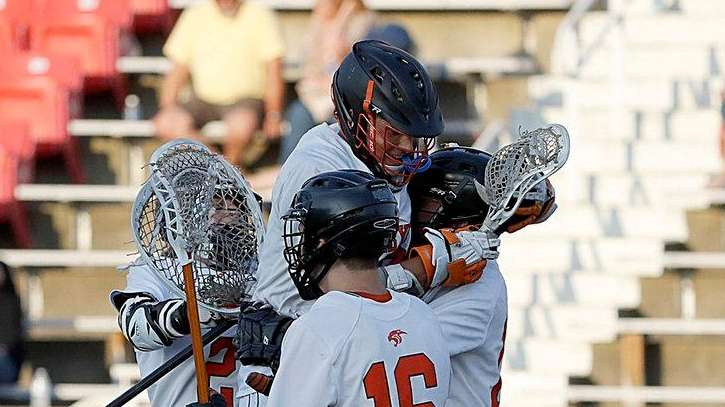 Babylon lacrosse players celebrate their victory over Mattituck/Greenport/Southold