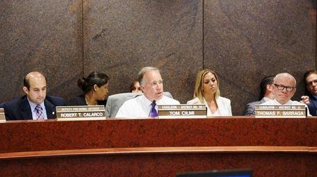 Legislator Tom Cilmi, center, speaks during a meeting