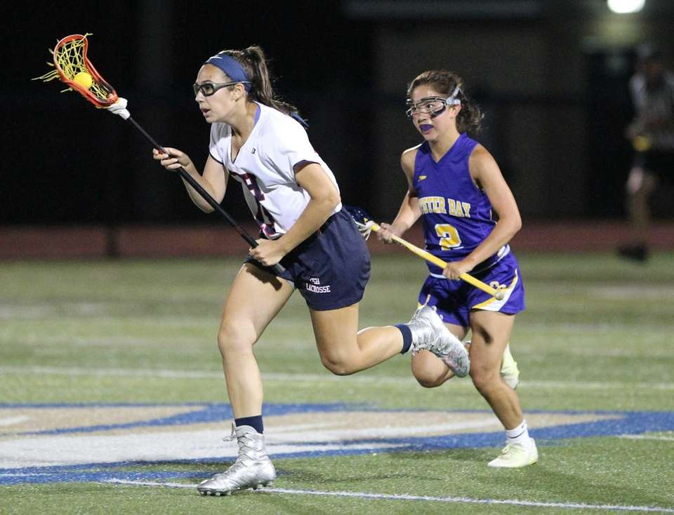 Cold Spring Harbor's Emily Weld (15) carries the