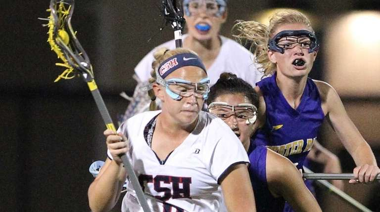 Cold Spring Harbor's Ashley Lynch (9) brings the