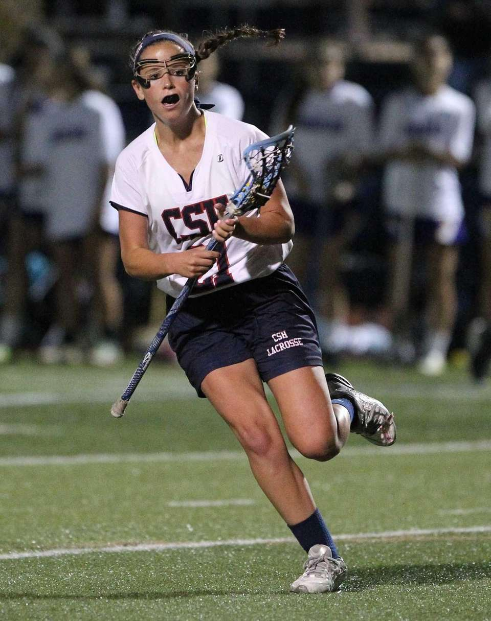 Cold Spring Harbor's Katie Hudson (21) carries the