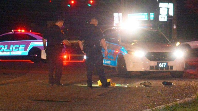 Suffolk County police investigate the scene where a