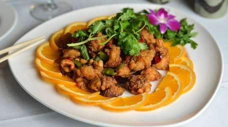 Sichuan chicken with walnuts, peanuts, and cashews, is