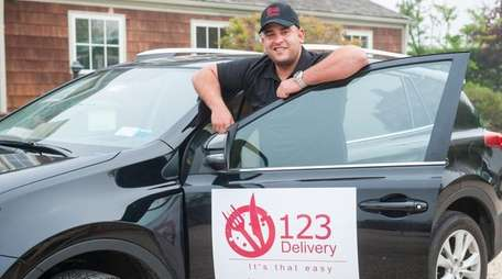 Mark Ripolone, owner of 123 Delivery, a new