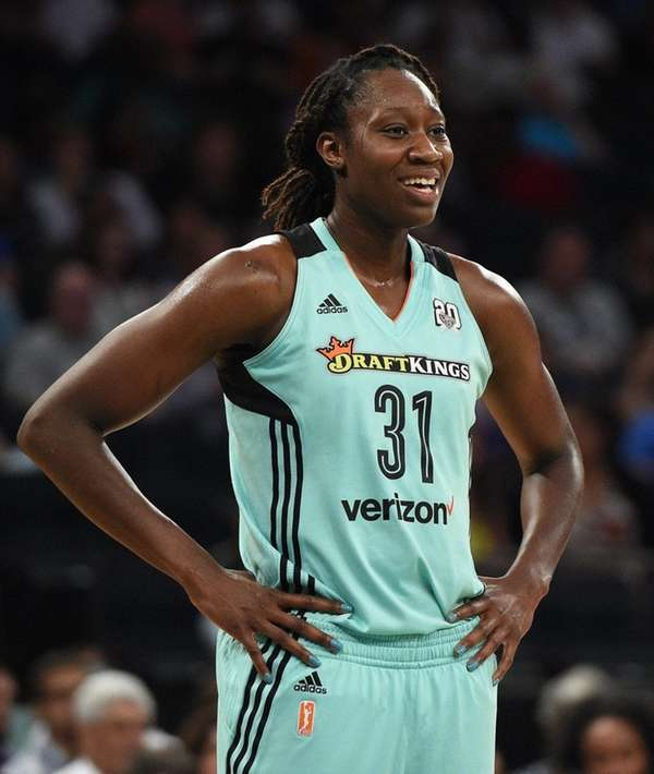 New York Liberty center Tina Charles looks on