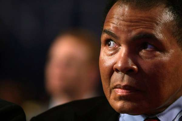 Muhammad Ali attends the opening session of the