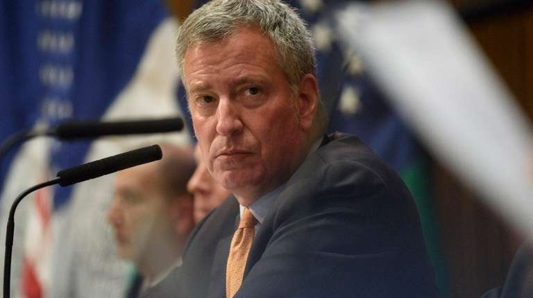 Mayor Bill de Blasio attends a news conference