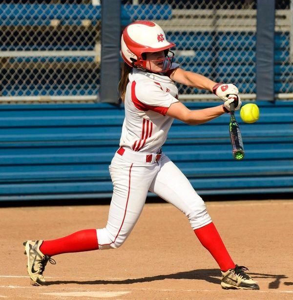 Center Moriches' Kayla Hujber (#4) swings at ball