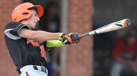 East Rockaway's Chris Deptulski (15) hits a long